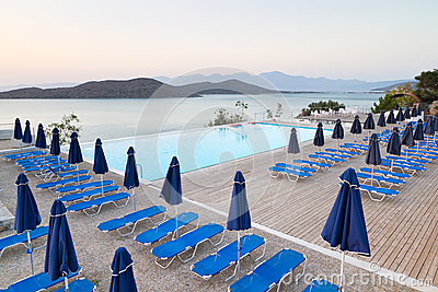 Swimming pool with sunbeds at Mirabello Bay