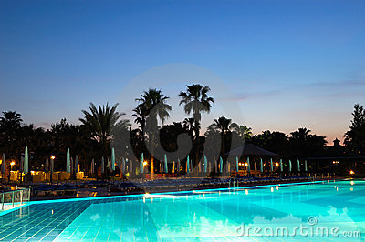 Swimming pool and sunset at popular hotel