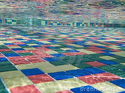 a background with a underwater view of the tiles pattern in a swimming pool