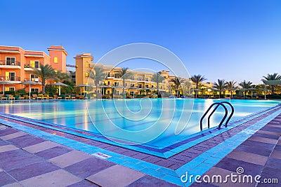 Swimming pool of tropical resort in Hurghada at night