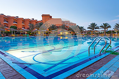 Swimming pool of tropical resort in Hurghada at night