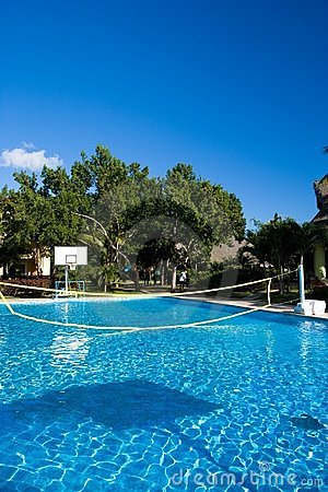 Swimming pool with a volleyball net at a resort in