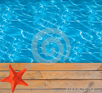 Free Swimming Pool With Blue Clear Water And Wooden Deck With Star-fish Stock Images - 63556094