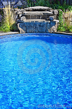 Free Swimming Pool With Waterfall Royalty Free Stock Photo - 22338895