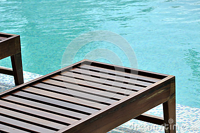 Swimming pool wooden longue