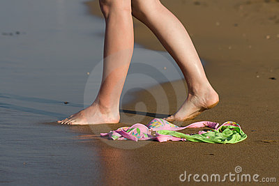 Swimwear on the beach and woman walking to the sea