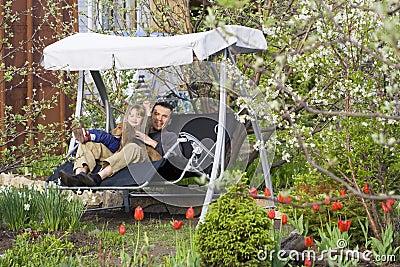 Swing in a blooming garden
