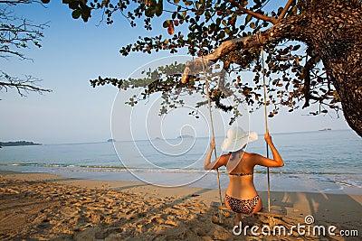Swing on paradise beach