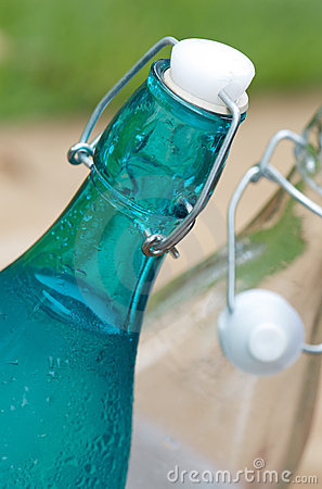 Swing top cap bottles