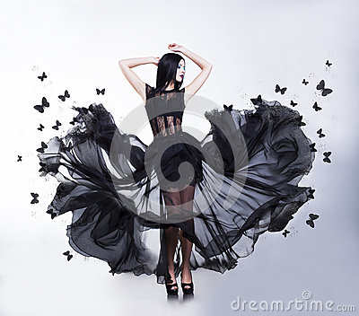 Swing. Woman in Fluttering Dress with Butterflies