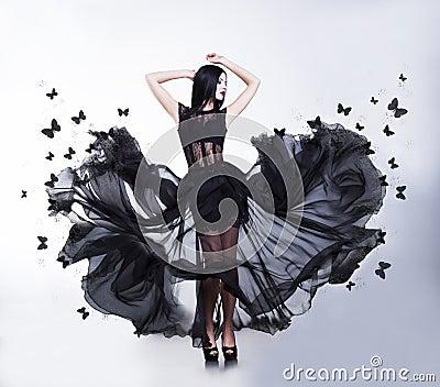 Swing. Woman in Fluttering Dress with Butterflies