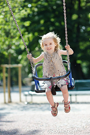 Swinging preschooler girl