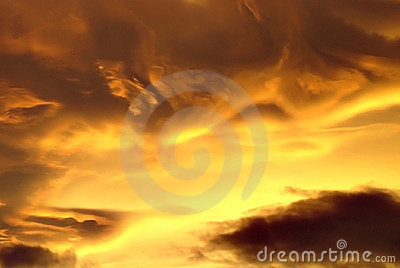 Swirled yellow and black clouds at sunset