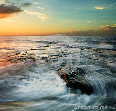 Free Swirling Waves At Sunset Royalty Free Stock Image - 28800946