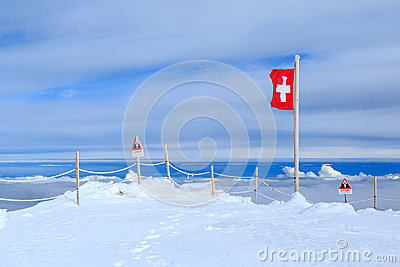 A Swiss flag above the clouds