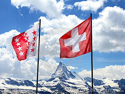 Swiss flags in front of Matterhorn