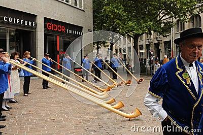 Swiss Folkolre: Alphorn musicians at the swiss national day play Editorial Stock Photo