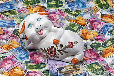 Swiss franc and piggy bank