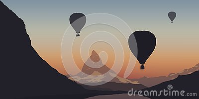 Three hot air balloons flying over the Matterhorn in Switzerland during a tourist program Stock Photo