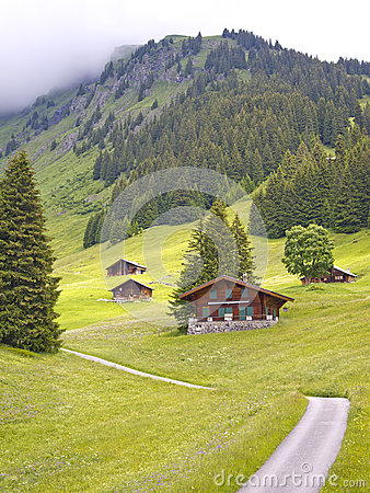 Free Swiss Styled Huts In The Alps Valley Stock Image - 25466341