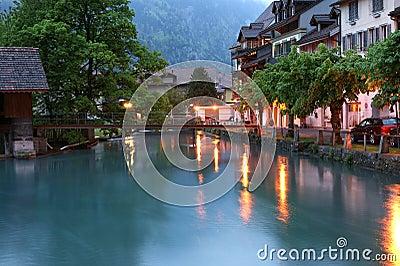 Switzerland, Interlaken. Evening view of a small r