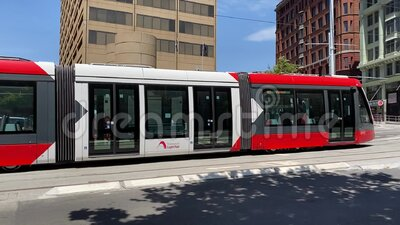Light rail running through Hay st. capitol theatre at Sydney China Town. stock footage