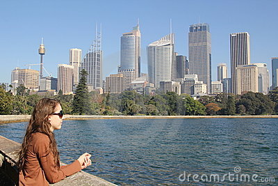 Sydney skyline and bay with young woman