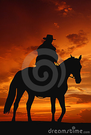Sylwetka kowbojski wschód słońca