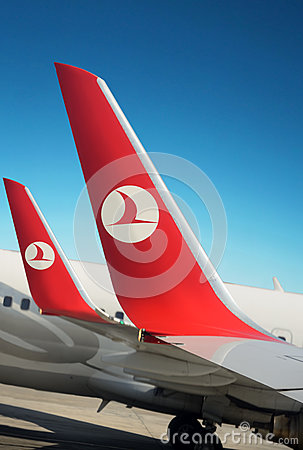 Logo Turkish airlines on plane wings. Blue sky Editorial Image