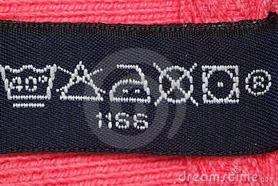 Symbols on label clothes. Close up.