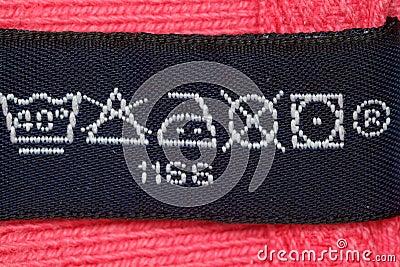 Symbols on label clothes. Close up.