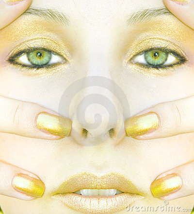 Symmetric gold face of woman
