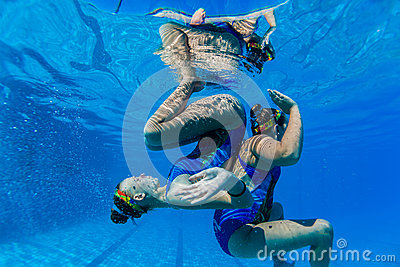 Synchronized Swim Pairs Underwater  Editorial Image