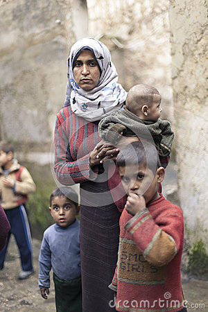 Free Syrian Mother With Her Childern In Aleppo. Stock Images - 34480874