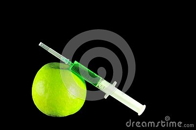 Syringe and apple