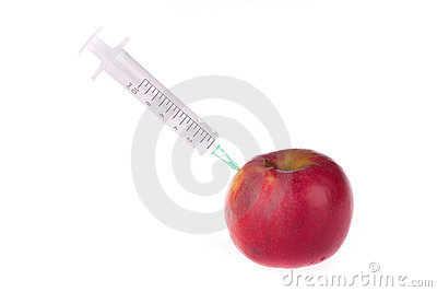 Syringe in the apple