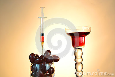 Syringe and grapes juice sample