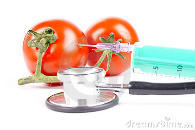 Syringe and tomatoes