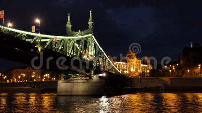 Szabadság aka Liberty Bridge at Night from the Danube in Budapest, Hungary stock footage
