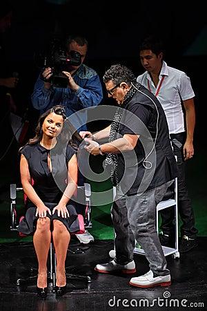 T.Hartley makes hairstyle for Natasha Koroleva Editorial Stock Image