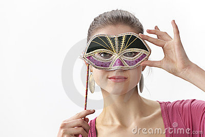 T teenage girl with a Venitian mask
