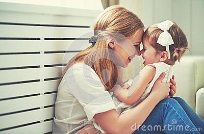 stock image of  happy loving family. mother and child playing, kissing and hugg