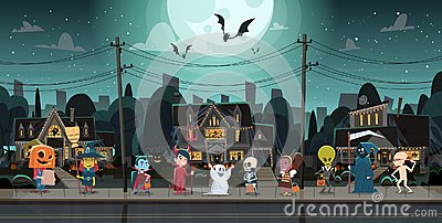 stock image of  kids wearing monsters costumes walking in town tricks or treat happy halloween banner holiday concept