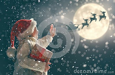 stock image of  girl with present at christmas