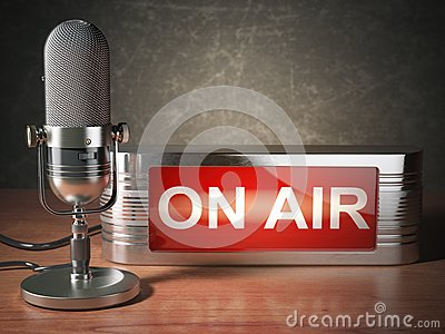 stock image of  vintage microphone with signboard on air. broadcasting radio station concept.