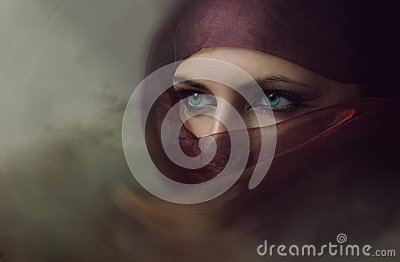 stock image of  young arabian woman in hijab with sexy blue eyes