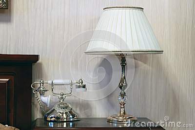 Table and bedside lamp with telephone
