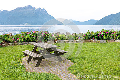 Table and benches for picnic on fjord shore