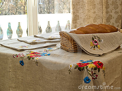 Table with bread and table-cloth