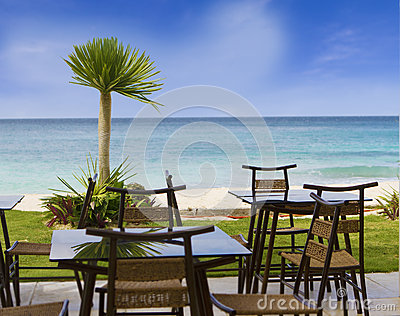 Table and chairs in restaurant on tropical beach